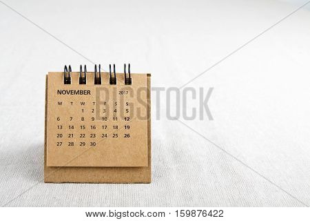 November. Calendar sheet. Two thousand and seventeen year calendar on bright background with copy space on right side.