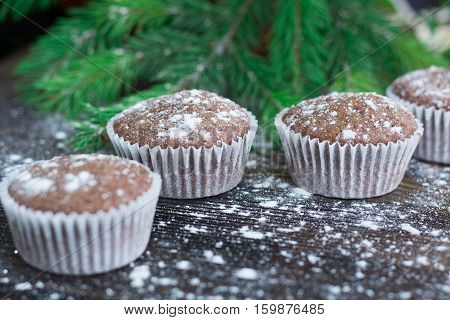 Christmas Cakes On Winter Snowbound Wooden Background, Fir Tree Branches