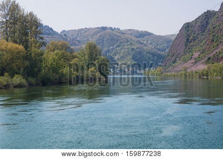 The scenic River Moselle and surrounded by hills.