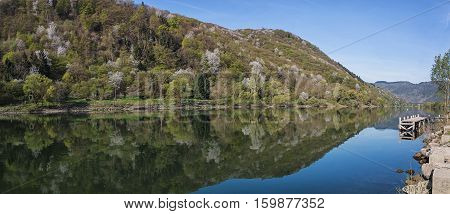 The scenic River Moselle and a mirror image of the surrounding hills.