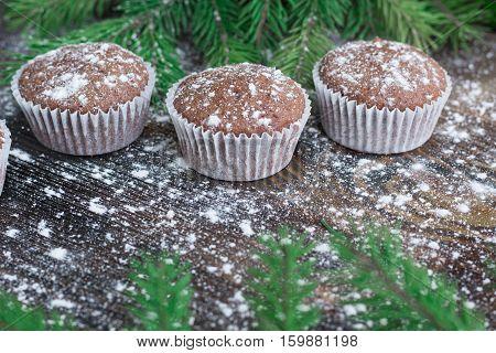 Three Christmas Cakes, Winter Snowbound Wooden Background, Fir Tree