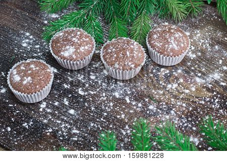 Four Christmas Cakes, Winter Snowbound Wooden Background, Fir Tree