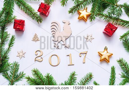 New Year 2017 background- 2017 figures,Christmas toys, fir branches and rooster- New Year 2017 symbol.Concept of Happy New Year 2017 holiday- New year of red rooster. Flat lay top view vintage tones