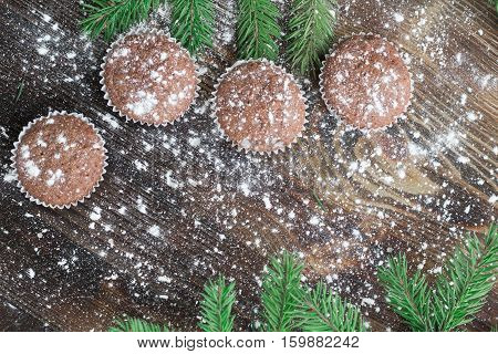 Four Christmas Cakes, Winter Snowbound Wooden Background, Fir Branches
