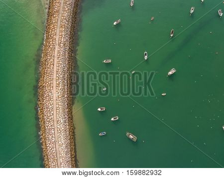 Aerophotography view from above breakwaters boat. Albufeira Marina port