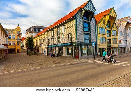 STAVANGER NORWAY - OCTOBER 10 2016: Unidentified people walking on the sidewalk of a shopping street in Stavanger Norway.