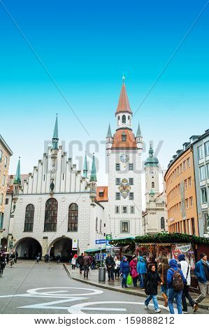 MUNICH - NOVEMBER 30: Old town hall at Marienplarz with people on November 30 2015 in Munich. It's the 3rd largest city in Germany after Berlin and Hamburg with a population of around 1.5 million.