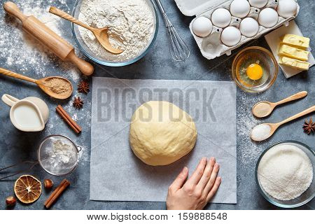Dough mixing recipe bread, pizza or pie making ingridients, food flat lay on kitchen table background. Working with butter, milk, yeast, flour, eggs, sugar pastry or bakery cooking.