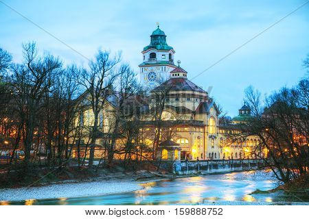The Volksbad with the Clocktower in Munich Germany at sunrise
