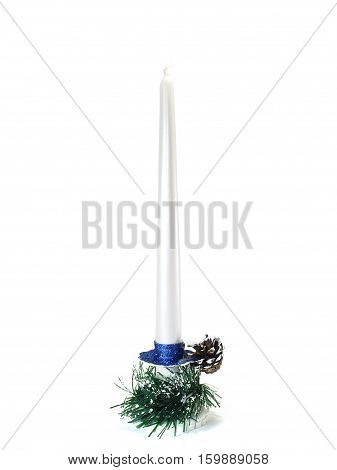 Candle on a candlestick boot with gifts and pine cone isolated on white background