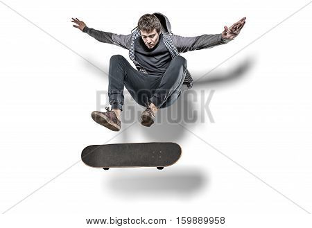 Skateboarder making trick in the air with shadow behind isolated on white background