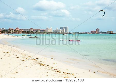 Kite surfing on Palm Beach on Aruba island in the Caribbean Sea