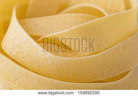 close up of raw uncooked italian pappardelle pasta noodle