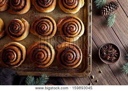 Sweet Homemade christmas baking. Cinnamon rolls buns with cocoa filling. Kanelbulle swedish dessert. Cinnabon roll bread, homemade bakery.