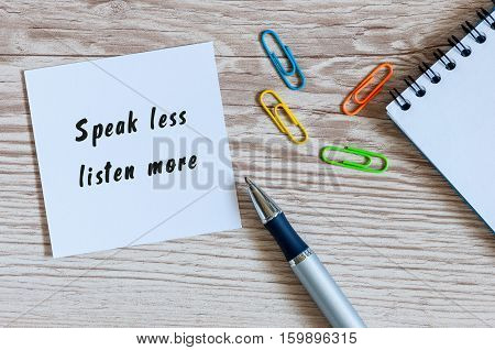 Speak Less Listen More notice on business background.