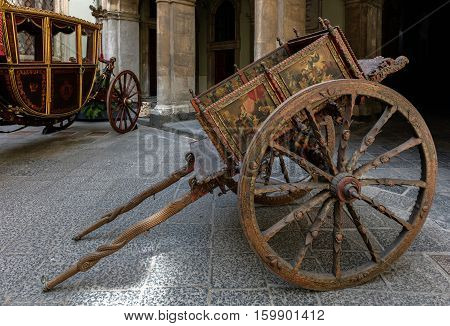 CATANIA ITALY - AUGUST 17 2016: The Sicilian cart is an ornate colorful style of horse or donkey-drawn cart native to the island of Sicily in Italy.