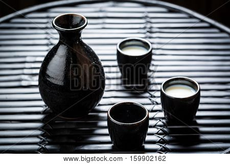 Delicious Sake In Asian Restaurant On Black Table