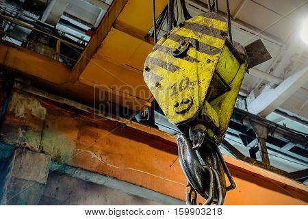 Hook industrial crane suspension. Heavy bridge crane.