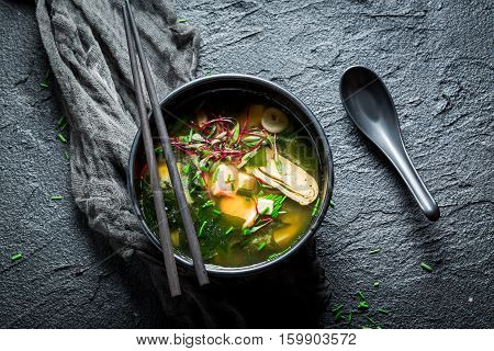 Hot Miso Soup With Salmon In Black Bowl