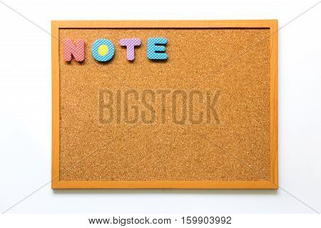 Brown cork board with wording note on white background