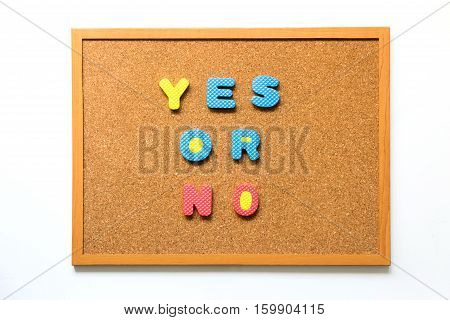 Brown cork board with wording yes or no on white background