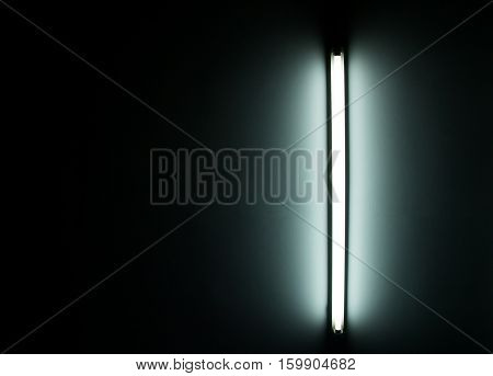 Detail of a fluorescent light tube on a wall. fluorescent light tube with copyspace for any design