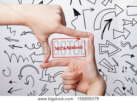 Technology, Internet, Business And Marketing. Young Business Woman Writing Word: Seo & Adwords
