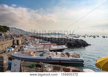 Naples Italy - August 30 2016: Foggy morning view of port in Naples one of the biggest city in Italy.