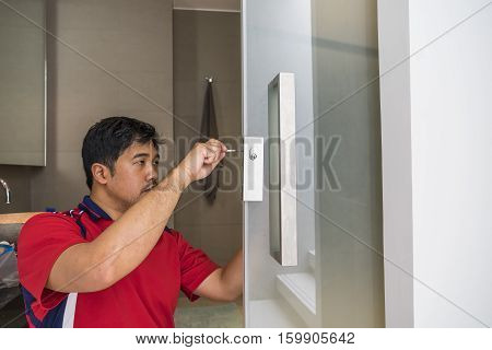 locksmith repair the lock on glass door scene - can use to display or montage on product