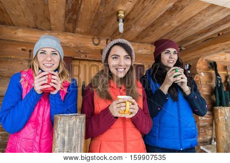 Young Girl Group On Terrace Holding Cup Hot Coffee Tea Wooden Country House Winter Resort Cottage Vacation