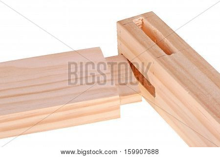 Close-up of the ends of pine boards with two freshly cut woodworking mortises and a tenon isolated against a white background