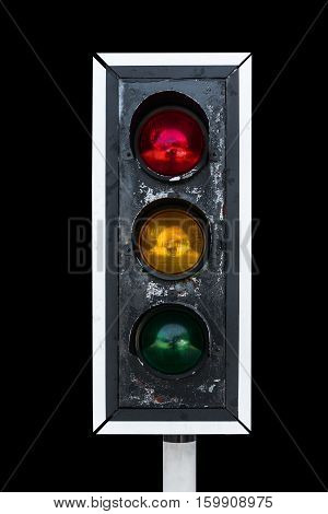 Old traffic light, isolated on black background
