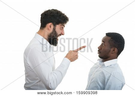 Closeup portrait of two grown mad men arguing, isolated on white background. Negative emotion facial expression feelings, attitude, reaction. Conflict