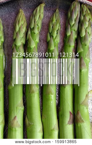 Barcode on asparagus background. Wholesale and retail concept.