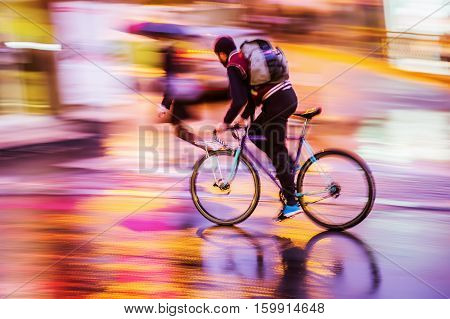 Bicycle Rider At Night Traffic