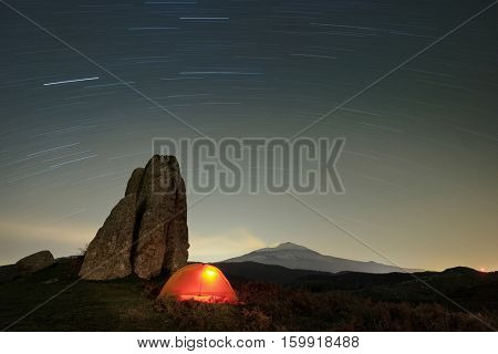 stars trails on lighting tent and megalith of Argimusco Highland, Sicily