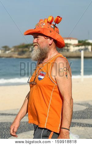 RIO DE JANEIRO, BRAZIL - AUGUST 6, 2016: Dutch fan after Rio 2016 Olympic Cycling Road route competition of the Rio 2016 Olympic Games at Copacabana beach in Rio de Janeiro