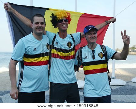 RIO DE JANEIRO, BRAZIL - AUGUST 6, 2016: Belgian fans celebrate victory after Rio 2016 Olympic Cycling Road route competition of the Rio 2016 Olympic Games at Copacabana beach in Rio de Janeiro