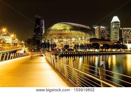 SINGAPORE - NOVEMBER 23 2016: night scene at Esplanade theatre on NOVEMBER 2016. Esplanade theatre is a 60000 square metres performing arts center located in Marina Bay.
