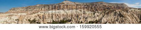 Wide panoramic photo of beautiful mountains near Goreme, Cappadocia, Turkey