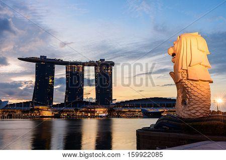 SINGAPORE - NOVEMBER 23 2016: silhouette of Merlion Statue at Marina Bay against the sunrise. Merlion is a well known marketing icon of Singapore depicted.
