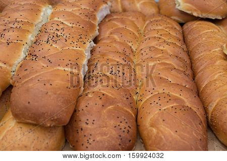 Fresh buns with black sesame seeds for sale at city market