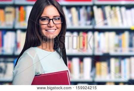 Portrait of a woman in a library