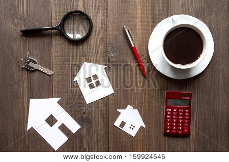 concept of buying house on wooden background top view.