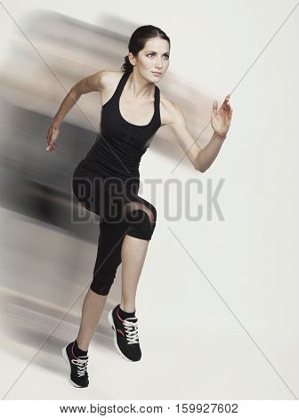 Young Running Caucasian Woman Studio Isolated On Bg With Blur Motion