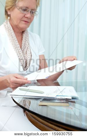 Senior woman looking through her letters in memory box