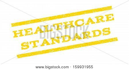 Healthcare Standards watermark stamp. Text tag between parallel lines with grunge design style. Rubber seal stamp with dirty texture. Vector yellow color ink imprint on a white background.