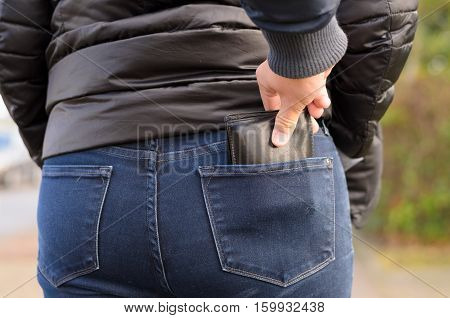 Pickpocket Stealing A Purse From A Woman