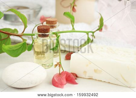 Plant-based cosmetic with tropical blossom relaxation set. Herbal skincare beauty treatment. Essential oil, fresh flower. Feminine toiletries.