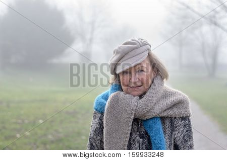 Stylish Elderly Woman On A Cold Winter Day